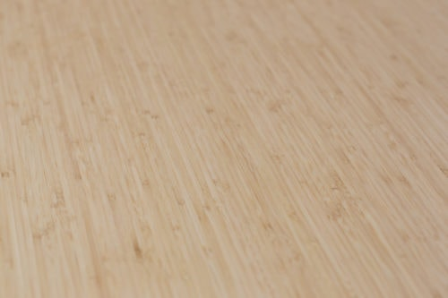 Mid brown bamboo desk top close up