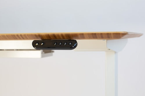 Mid brown bamboo beveled front & side edge. Controller.